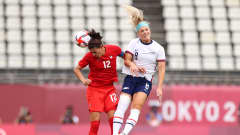KASHIMA, JAPAN - AUGUST 02: Christine Sinclair #12 of Team Canada competes for a header with Julie Ertz #8 of Team United States during the Women's Semi-Final match between USA and Canada on day ten of the Tokyo Olympic Games at Kashima Stadium on August 02, 2021 in Kashima, Ibaraki, Japan. (Photo by Naomi Baker/Getty Images)