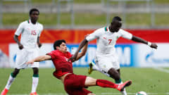 HAMILTON, NEW ZEALAND - MAY 31:  Goncalo Guedes of Portugal and Ibrahima Wadji of Senegal battle for the ball during the FIFA U-20 World Cup New Zealand 2015 Group C match between Portugal and Colombia held at Waikato Stadium on May 31, 2015 in Hamilton, New Zealand.  (Photo by Dean Mouhtaropoulos - FIFA/FIFA via Getty Images)