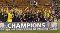 TOKYO, JAPAN - SEPTEMBER 08:  The USA team celebrates with the trophy after  winning the FIFA U-20 Women's World Cup Final match between USA and Germany at the National Stadium on September 8, 2012 in Tokyo, Japan.  (Photo by Ian Walton - FIFA/FIFA via Getty Images)