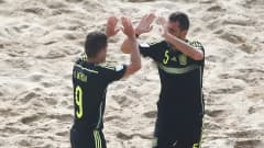 ESPINHO, PORTUGAL - JULY 14:  Raul Merida of Spain celebrates scoring his teams first goal of the game with Juanma during the Group C FIFA Beach Soccer World Cup match between Brazil and Spain held at Espinho Stadium on July 14, 2015 in Espinho, Portugal.  (Photo by Dean Mouhtaropoulos - FIFA/FIFA via Getty Images)