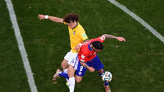 BELO HORIZONTE, BRAZIL - JUNE 28: David Luiz of Brazil challenges Mauricio Pinilla of Chile during the 2014 FIFA World Cup Brazil round of 16 match between Brazil and Chile at Estadio Mineirao on June 28, 2014 in Belo Horizonte, Brazil.  (Photo by Francois Xavier Marit - Pool/Getty Images)