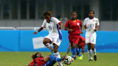 NANJING, CHINA - AUGUST 25:  Ignacia Haoses of Namibia challenges Margret Joseph of Papua New Guinea during the 2014 FIFA Girls Summer Youth Olympic Football Tournament 5th/6th Place Playoff match between Papua New Guinea and Namibia at Jiangning Sports Centre Stadium on August 25, 2014 in Nanjing, China.  (Photo by Stanley Chou - FIFA/FIFA via Getty Images)