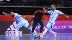 KAUNAS, LITHUANIA - OCTOBER 03: Zicky of Portugal battles for possession with Pablo Taborda and Angel Claudino of Argentina during the FIFA Futsal World Cup 2021 Final match between Argentina and Portugal at Kaunas Arena on October 03, 2021 in Kaunas, Lithuania. (Photo by Alex Caparros - FIFA/FIFA via Getty Images)