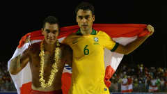 Heimanu Taiarui of Tahiti and Bruno of Brazil are seen after the FIFA Beach Soccer World Cup Tahiti 2013 Thrid Place Match