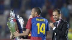 Barcelona´s French forward Thierry Henry (C) and Barcelona´s coach Josep Guardiola celebrate with the Champions League Cup