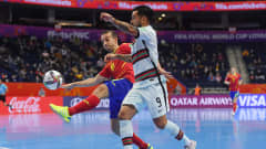 VILNIUS, LITHUANIA - SEPTEMBER 27: Joao Matos of Portugal is challenged by Adri Martinez of Spain during the FIFA Futsal World Cup 2021 Quarter Final match between Spain and Portugal at Vilnius Arena on September 27, 2021 in Vilnius, Lithuania. (Photo by Alex Caparros - FIFA/FIFA via Getty Images)