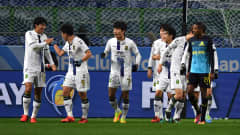SUITA, JAPAN - DECEMBER 14:  Lee Jongho of Jeonbuk Hyundai celebrates with team mates after scoring his sides second goal during the FIFA Club World Cup 5th Place match between Jeonbuk Hyundai and Mamelodi Sundowns at Suita City Football Stadium on December 14, 2016 in Suita, Japan.  (Photo by Mike Hewitt - FIFA/FIFA via Getty Images)