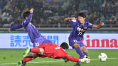 Yusuke Minagawa of Sanfrecce Hiroshima scores his teams first goal during the FIFA Club World Cup: Play-off match for the  quarter final between Sanfrecce Hiroshima and Auckland City FC at International Stadium Yokohama on December 10, 2015 in Yokohama, Japan.  (Photo by Atsushi Tomura/Getty Images)
