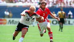 10 JUL 1994: TRIFON IVANOV #3 OF BULGARIA BATTLES WITH RUDY VOLLER #13 OF GERMANY FOR THE BALL DURING BULGARIA'S 2-1 VICTORY OVER GERMANY IN THE QUARTER FINALS OF THE 1994 WORLD CUP AT GIANTS STADIUM IN THE MEADOWLANDS, NEW JERSEY.