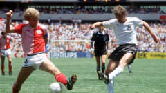 1986 World Cup Finals, Queretaro, Mexico, 13th June, 1986, Denmark 2 v West Germany 0,Denmark's Morten Olsen tries to block a shot from West Germany's Rudi Voeller (Photo by Bob Thomas/Getty Images)
