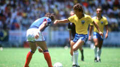 Zico of Brazil takes on an French defender during the FIFA World Cup Mexico 1986. David Cannon/ALLSPORT/Getty Images