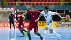 CALI, COLOMBIA - OCTOBER 01: Miguel Castro (L) of Portugal conducts the ball next to Hossein Tayebi (R) of Iran during the FIFA Futsal World Cup Third Place Play off match between Iran and Portugal at the Coliseo El Pueblo stadium on October 1, 2016 in Cali, Colombia. (Photo by Alex Caparros - FIFA/FIFA via Getty Images)