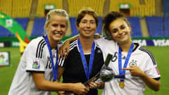 MONTREAL, QC - AUGUST 24:  Head coach Maren Meinert (C), Lena Petermann (L) and Lina Magull of Germany pose after winning the FIFA U-20 Women's World Cup Canada 2014 final match between Nigeria and Germany at Olympic Stadium on August 24, 2014 in Montreal, Canada.  (Photo by Alex Grimm - FIFA/FIFA via Getty Images)