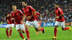 Al-Ahly's forward Mohamed Aboutrika (C) celebrates after scoring
