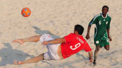 DUBAI, UNITED ARAB EMIRATES - NOVEMBER 17: Dejan Stankovic of of Switzerland tries an overhead kick as Victor Tale of Nigeria looks on during the Group D FIFA Beach Soccer World Cup match between Nigeria and Switzerland at the Umm Suqeim beach on November 17, 2009 in Dubai, United Arab Emirates. (Photo by Mike Hewitt - FIFA/FIFA via Getty Images)