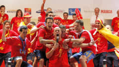 Pepe Reina leads the song during Spain's FIFA World Cup victory parade