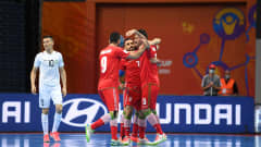 VILNIUS, LITHUANIA - SEPTEMBER 24: Ali Hassanzadeh of Iran celebrates with teammates after scoring their team's first goal during the FIFA Futsal World Cup 2021 Round of 16 match between Uzbekistan and Iran at Vilnius Arena on September 24, 2021 in Vilnius, Lithuania. (Photo by Alexander Scheuber - FIFA/FIFA via Getty Images)