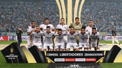 Players of Lanus line up for a picture