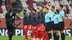 DOHA, QATAR - FEBRUARY 11: The FC Bayern Muenchen team and match officials line up prior to the FIFA Club World Cup Qatar 2020 Final between FC Bayern Muenchen and Tigres UANL at the Education City Stadium on February 11, 2021 in Doha, Qatar. (Photo by Fadi El Assaad - FIFA/FIFA via Getty Images)