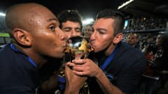 ABU DHABI, UNITED ARAB EMIRATES - DECEMBER 18: Maicon and Lucio of Inter Milan celebrate with the trophy during the FIFA Club World Cup Final between TP Mazembe Englebert and FC Internazionale Milano at Zayed Sports City on December 18, 2010 in Abu Dhabi, United Arab Emirates.  (Photo by Michael Regan - FIFA/FIFA via Getty Images)