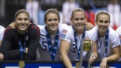 VANCOUVER, CANADA - JANUARY 29:  Goalie Hope Solo #1, Kelley O'Hara #5, Christie Rampone #3 and Heather Mitts #2 of the United States pose for a photo after defeating Canada in the championship game of the 2012 CONCACAF Women's Olympic Qualifying Tournament at BC Place on January 29, 2012 in Vancouver, British Columbia, Canada. The United States and Canada qualified for the 2012 Summer Olympic Games in London.  (Photo by Rich Lam/Getty Images)