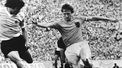 Johan Cruyff of the Netherlands cuts inside an opponent during their 2-0 victory over Uruguay in their 1974 FIFA World Cup™ curtain-raiser.