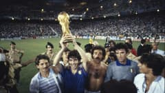 Italy's Paolo Rossi lifts aloft the FIFA World Cup Trophy.