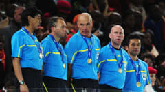 Referee Howard Webb (C) lines up for the presentation with Assistant referees Michael Mullarkey (2ndR) and Darren Cann (2ndL), and Fourth Official Yuichi Nishimura (L) following the 2010 FIFA World Cup South Africa Final match between Netherlands and Spain at Soccer City Stadium on July 11, 2010 in Johannesburg, South Africa. (Photo by Clive Mason/Getty Images)