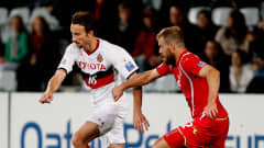 ADELAIDE, AUSTRALIA - MAY 29: Josh Kennedy of Adelaie United tries to get past Iain Fyfe during the AFC Asian Champions League match between Adelaide United and Nagoya Grampus at Hindmarsh Stadium on May 29, 2012 in Adelaide, Australia.