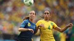 Lotta Schelin of Sweden (L) and Rafaelle of Brazil compete for the ball