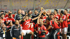 Egypt's al-Ahly team pose with the trophy after winning 2-1 against Esperance