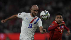 SANTIAGO, CHILE - OCTOBER 10: Carlos Gonzalez of Paraguay and Paulo Diaz of Chile fight for the ball  during a match between Chile and Paraguay as part of South American Qualifiers for Qatar 2022 at Estadio San Carlos de Apoquindo on October 10, 2021 in Santiago, Chile. (Photo by Esteban Felix - Pool/Getty Images)