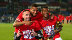 MARRAKECH, MOROCCO - DECEMBER 21: Franck Ribery, Jerome Boateng and David Alaba of FC Bayern Munchen lift the FIFA Club World Cup after victory in the FIFA Club World Cup Final between FC Bayern Munchen and Raja Casablanca at Marrakech Stadium on December 21, 2013 in Marrakech, Morocco.  (Photo by Alex Livesey - FIFA/FIFA via Getty Images)