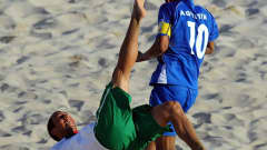 RAVENNA, ITALY - SEPTEMBER 11: Lucio of Portugal does a overhead kick next to Agustin Ruiz of El Salvador during the FIFA Beach Soccer World Cup 3rd Place Playoff match between El Salvador and Portugal at Stadium del Mare on September 11, 2011 in Ravenna, Italy. (Photo by Lars Baron - FIFA/FIFA via Getty Images)