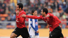 Al Ahly's Mohamed Aboutrika and Ahmed Fathi celebrate a goal against Pachuca