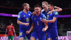 KAUNAS, LITHUANIA - SEPTEMBER 30: Birzhan Orazov of Kazakhstan celebrates with teammates Chingiz Yessenamanov, Arnold Knaub and Dauren Tursagulov after scoring their team's first goal which was later disallowed during the FIFA Futsal World Cup 2021 Semi-Final match between Portugal and Kazakhstan at Kaunas Arena on September 30, 2021 in Kaunas, Lithuania. (Photo by Alex Caparros - FIFA/FIFA via Getty Images)