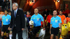 Referee Howard Webb leads the teams out onto the pitch ahead of the 2010 FIFA World Cup South Africa Final match between Netherlands and Spain at Soccer City Stadium on July 11, 2010 in Johannesburg, South Africa. (Photo by Lars Baron/Getty Images)