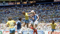 1986 World Cup Quarter Final, Guadalajara, Mexico, 21st June, 1986, France 1 v Brazil 1, (France win 4-3 on penalties), Brazil's Edinho battles for the ball in the air as he jumps up with France's Patrick Battiston (Photo by Bob Thomas/Getty Images)