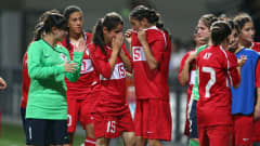 Turkey players show their dejection at full time after their defeat by Chile in the Girls Youth Olympic Football Tournament semi final match at the Jalan Besar Stadium on August 21, 2010 in Singapore, Singapore.