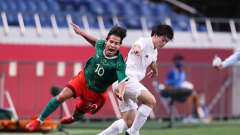 SAITAMA, JAPAN - AUGUST 06: Diego Lainez #10 of Team Mexico battles for possession with Yuki Soma #16 of Team Japan during the Men's Bronze Medal Match between Mexico and Japan on day fourteen of the Tokyo 2020 Olympic Games at Saitama Stadium on August 06, 2021 in Saitama, Tokyo, Japan. (Photo by Masashi Hara  - FIFA/FIFA via Getty Images)