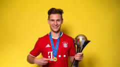 Joshua Kimmich of FC Bayern Muenchen posing with the FIFA Club World Cup trophy (David Ramos / Getty)