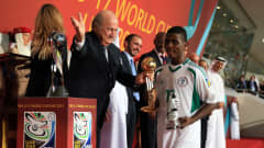 ABU DHABI, UNITED ARAB EMIRATES - NOVEMBER 08:  Kelechi Iheanacho of Nigeria recieves the Golden Ball and the Silver Boot from FIFA President Joseph S. Blatter during the FIFA U-17 World Cup UAE 2013 Final between Nigeria and Mexico at the Mohamed Bin Zayed Stadium on November 8, 2013 in Abu Dhabi, United Arab Emirates.  (Photo by Richard Heathcote - FIFA/FIFA via Getty Images)