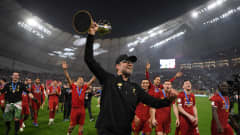 DOHA, QATAR - DECEMBER 21: Jurgen Klopp, Manager of Liverpool celebrates with the FIFA Club World Cup Qatar 2019 trophy during a lap of honor following their victory in the FIFA Club World Cup Qatar 2019 Final match between Liverpool FC and CR Flamengo at Khalifa International Stadium on December 21, 2019 in Doha, Qatar. (Photo by Mike Hewitt - FIFA/FIFA via Getty Images)