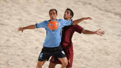 DUBAI, UNITED ARAB EMIRATES - NOVEMBER 22: Martin of Uruguay is challenged by Torres of Portugal during the FIFA Beach Soccer World Cup 3rd Place Playoff match between Portugal and Uruguay on November 22, 2009 in Dubai, United Arab Emirates. (Photo by Michael Regan - FIFA/FIFA via Getty Images)