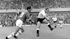 1966 FIFA World Cup England,  Germany - Switzerland 5:0  Ely Tacchella (SUI, le) and Uwe Seeler (GER)