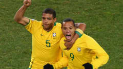 JOHANNESBURG, SOUTH AFRICA - JUNE 28: Luis Fabiano celebrates with his team mate Felipe Melo after scoring the equalising goal for Brazil during the FIFA Confederations Cup Final between USA and Brazil at the Ellis Park Stadium on June 28, 2009 in Johannesburg, South Africa. (Photo by Vladimir Rys/Bongarts/Getty Images)