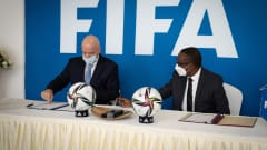 FIFA President Gianni Infantino and Vincent Biruta, Minister of Foreign Affairs and International Cooperation for Rwanda (Photo credit: Simon Wohlfahrt - AFP).
