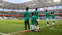 BIELSKO-BIALA, POLAND - JUNE 08: Players of Senegal take a moment of reflection before their warm up ahead of the 2019 FIFA U-20 World Cup Quarter Final match between Korea Republic and Senegal at Bielsko-Biala Stadium on June 08, 2019 in Bielsko-Biala, Poland. (Photo by Alex Livesey - FIFA/FIFA via Getty Images)