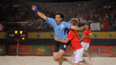 DUBAI, UNITED ARAB EMIRATES - NOVEMBER 21: Parrillo of Uruguay is fouled by Stephan Leu of Switzerland during the FIFA Beach Soccer World Cup Semi Final match between Switzerland and Uruguay at Umm Suqeim beach on November 21, 2009 in Dubai, United Arab Emirates.