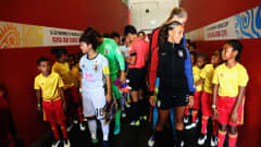 PORT MORESBY, PAPUA NEW GUINEA - DECEMBER 03:  Yuka Momiki of Japan and Mallory Pugh of the United States gather with their teams in the tunnel ahead of  the FIFA U-20 Women's World Cup Papua New Guinea 2016 Third Place Play Off match between USA and Japan at the National Football Stadium on December 3, 2016 in Port Moresby, Papua New Guinea.  (Photo by Matthew Lewis - FIFA/FIFA via Getty Images)